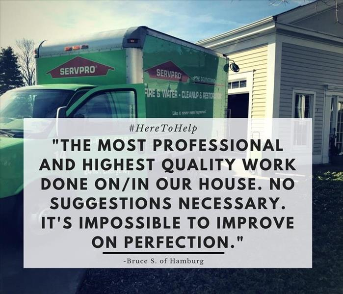 green servpro truck parked in front of house with block of text in front of it